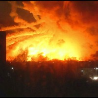 Pictures: 20,000 people evacuated from area after massive fire at Ukrainian arms depot