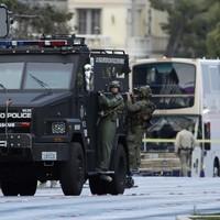 Suspect in Las Vegas Strip bus shooting surrenders to police