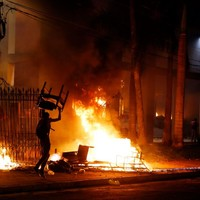 Activist shot dead as protesters storm government building in Paraguay