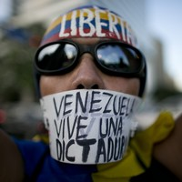 Venezuelan court rows back on move to seize power after being accused of coup