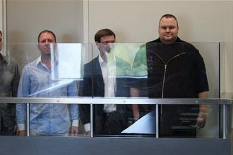 MegaUpload founder Kim Dotcom, far right with three of his employees in a New Zealand court today.