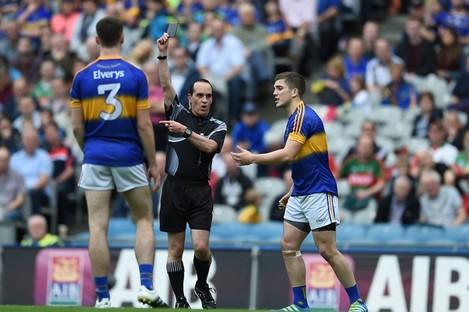 David Coldrick brandishes a black card to Robbie Kiely in last year's All-Ireland semi-final.