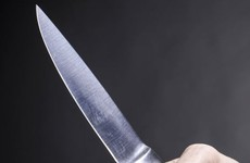 Woman in her 60s threatened by female with knife when she answered door