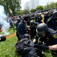 'Real men pay their taxes' - dozens arrested amid violent scenes during anti-Trump tax protests