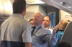 'Hit me. Bring it on': American Airlines worker suspended after squaring up to passenger