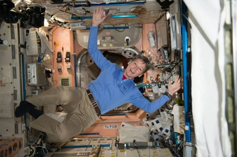 American astronaut Peggy Whitson celebrates after smashing the record for the most cumulative time in space by an American astronaut aboard the International Space Station.