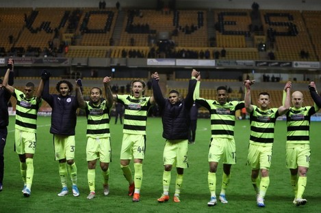 Huddersfield Town players celebrate securing a place in the Play Offs with victory over Wolves.