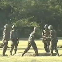 WATCH: Chinese soldiers pass around a live grenade