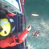 The moment a young surfer was rescued after 32 hours at sea