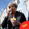 These photos of Theresa May awkwardly eating chips have become a huge meme