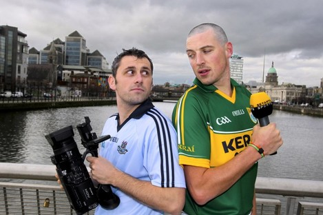 Donaghy and Alan Brogan pose on Sean O'Casey Bridge yesterday.