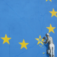 Banksy's new mural shows a man chipping away at the stars in the European flag
