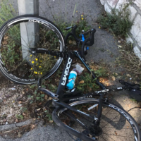 Chris Froome's bike 'totalled' after car follows him onto pavement
