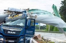 Driver has lucky escape after huge wind turbine blade hits lorry