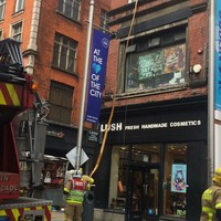 Firefighters respond to fire above Lush on Henry Street