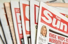 British police arrest 5 in tabloid bribery probe