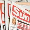 British police arrest 5 in tabloid bribery probe