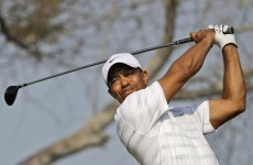 Woods leads in Abu Dhabi, as Irish contingent remain in contention