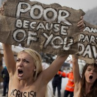 Slideshow: Topless protesters arrested at Davos summit