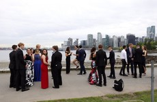 Justin Trudeau was out jogging and ended up brilliantly photobombing a group prom picture