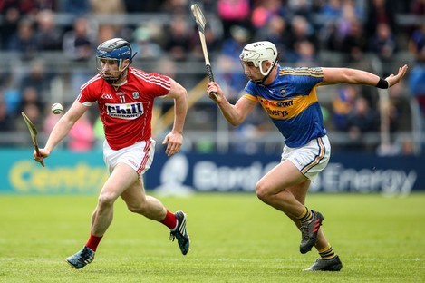 Cork's Conor Lehane goes up against Tipperary's Ronan Maher.
