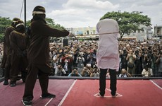 Two Indonesian men caned in front of jeering crowd for having sex
