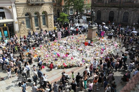Tributes in St Ann's Square, Manchester, to remember the victims of the terror attack in the city earlier this week.