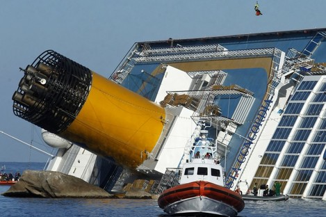 An Italian fireman descends from an helicopter to the grounded cruise ship Costa Concordia off the Tuscan island of Giglio, Italy, Saturday, Jan. 21, 2012.