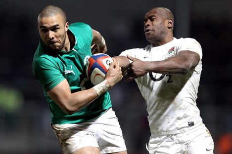 Simon Zebo hands off Ugo Monye of the England Saxons to score a late try on Saturday. Ireland Wolfhounds lost 23-17.