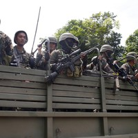 IS-linked militants have taken parts of a Philippine city and have been killing women and children