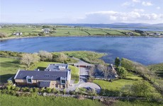 This modern coastal hideaway has its own thatched cottage and views of the Burren