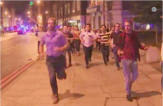 A photo of a man being evacuated in London last night and refusing to leave his pint behind has taken over Twitter