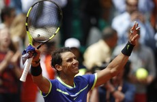 Nadal matches Federer's record at French Open as he powers into quarters