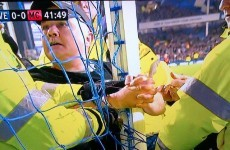 Fan handcuffs himself to the post during Everton's game with Man City