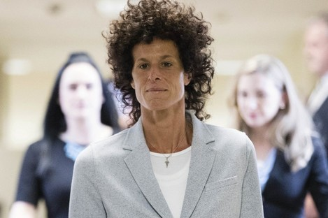 Andrea Constand walks to the courtroom during Bill Cosby's sexual assault trial.