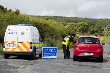 A garda at road block to the crime scene where part of a body was found by walkers on the Feartherbed Mountains on the Dublin Wicklow border.