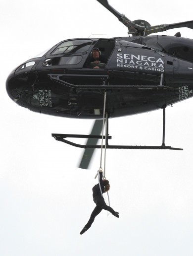 Daredevil woman hangs from helicopter above Niagara Falls... by her teeth
