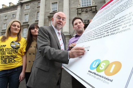 Ruairi Quinn signs a USI pledge in February, promising not to raise student contributions if he was in government after the election.