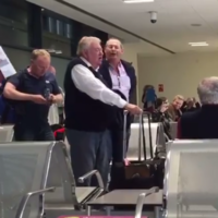 A Cork choir surprised passengers in Dublin Airport by serenading them as they boarded