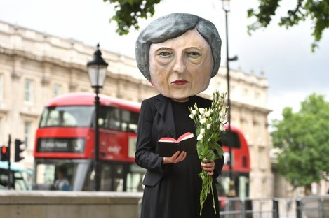 A puppet of UK PM Theresa May outside Westminster.