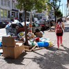 Rubbish is piling up on Athens' streets as temperatures soar