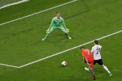 Alexis Sanchez puts Chile ahead against Germany.