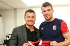 Brian O'Driscoll looks delighted to be presenting Peter O'Mahony with his Test jersey