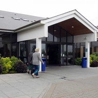 Crowds gather at Waterford hospital after man dies while being transferred to Cork