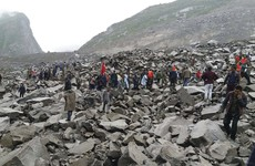 Over 140 people feared buried after landslide swallows Chinese village