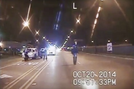 In this screenshot taken from a police dash-cam video, Laquan McDonald, right, walks down the street moments before being fatally shot.