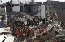 More than 40 people trapped after building collapses in Lahore