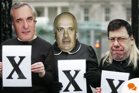 Members of Action on X wearing masks of former Taoisigh protest at the Dáil earlier today