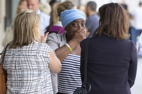Families of victims of the Grenfell Tower fire arrive at a meeting with the police and the coroner.