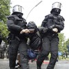 Protesters and police clash violently on first day of G20 summit